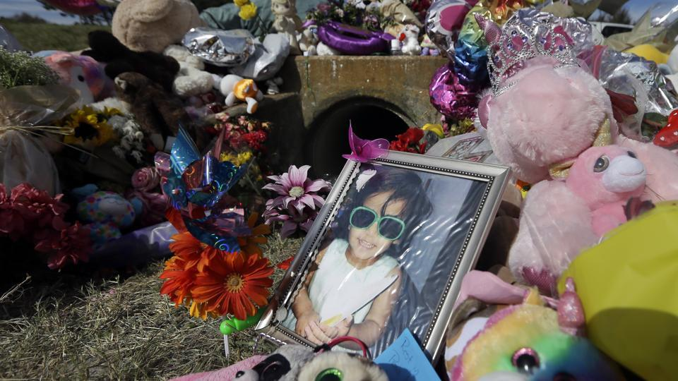 A photograph of 3-year-old Sherin Mathews sits by a makeshift memorial in Richardson, Texas.