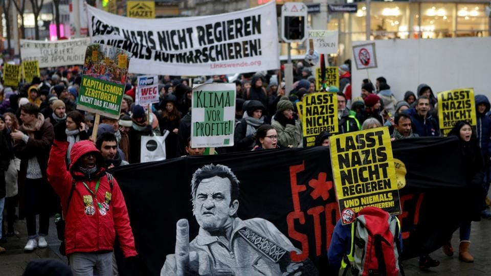 Protestors attend an anti-government demonstration in Vienna, Austria, January 13, 2018.Signs read (LtoR)