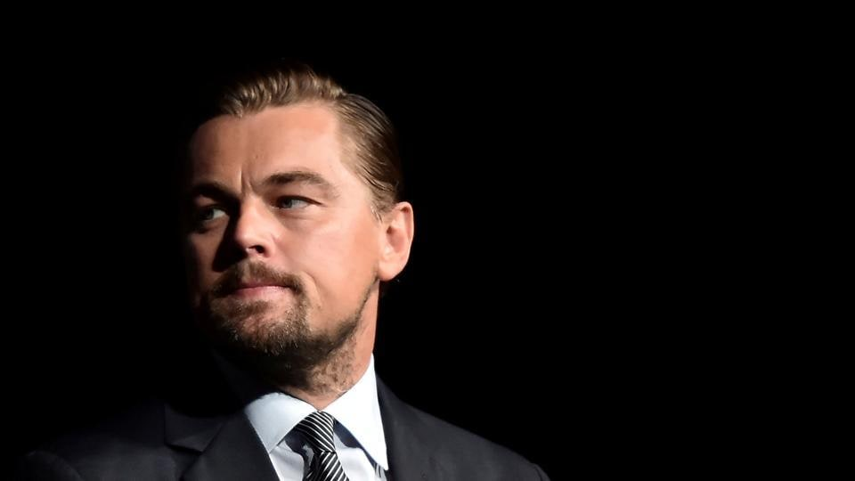Leonardo DiCaprio looks on prior to speaking on stage during the Paris premiere of the documentary film Before the Flood at the Theatre du Chatelet in Paris, France.