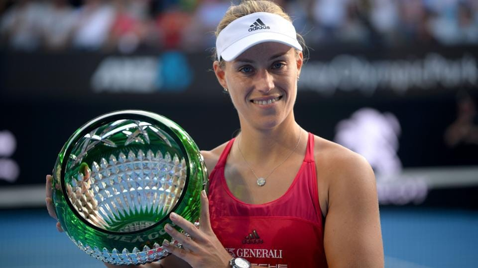 Angelique Kerber holds up the trophy after beating Ashley Barty in the Sydney International tennis final.