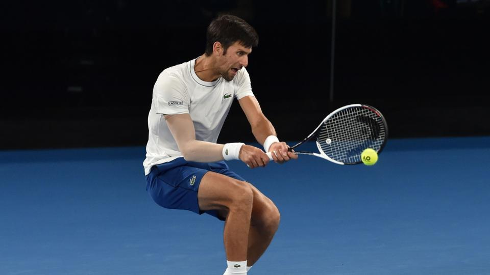 Serbia's Novak Djokovic hits a return during a practice session ahead of the Australian Open tennis tournament, starting January 15.
