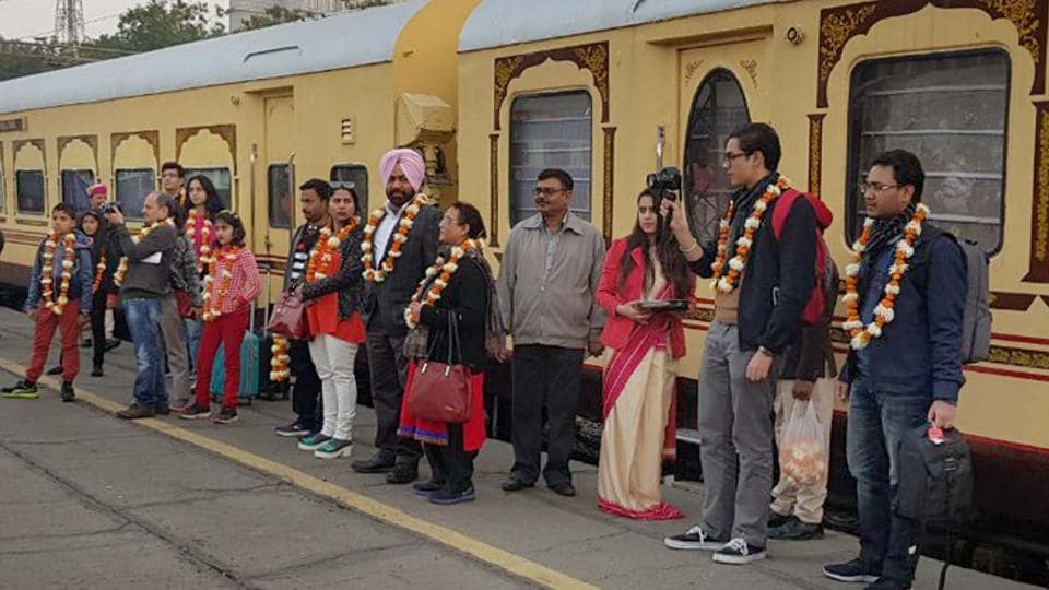 Tourists pose outside the Heritage Palace on Wheels (HPOW) train that reached Gandhi Nagar station of Jaipur.
