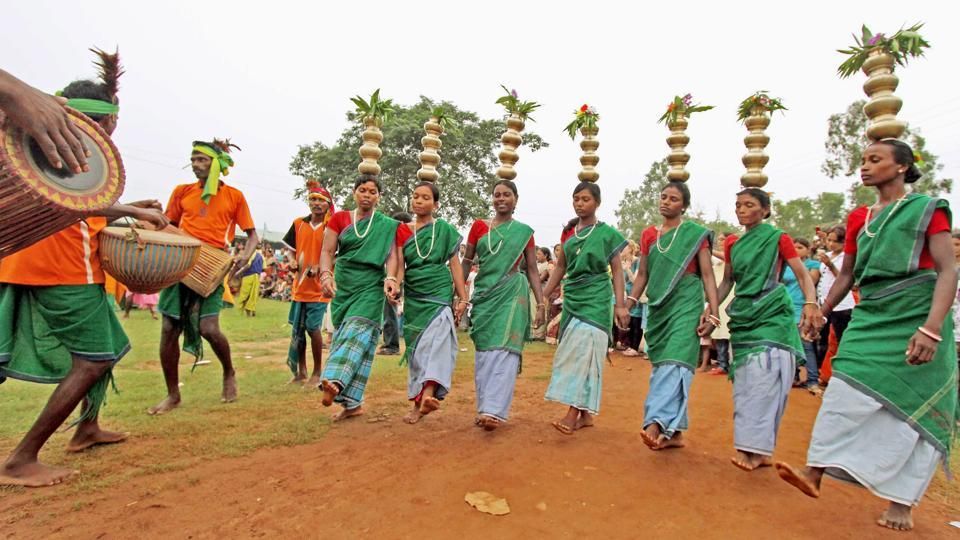 Tribals dance during the 'Badna Parab' festival on the eve of Maker Sankranti at Gopalnagar in Birbhum district of West Bengal. (PTI)