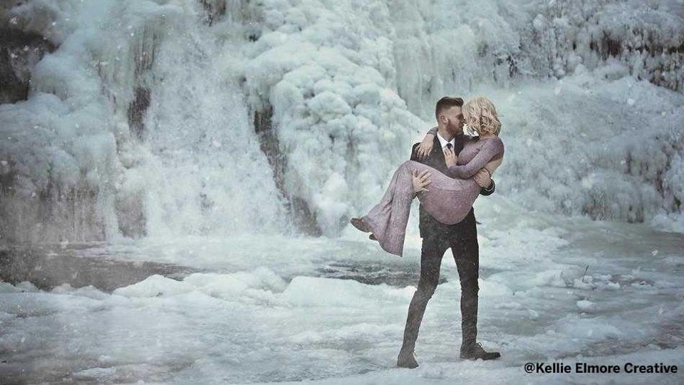 An American couple's engagement photos in the backdrop of a frozen waterfall is heating up social media (Kellie Elmore Creative/Instagram)