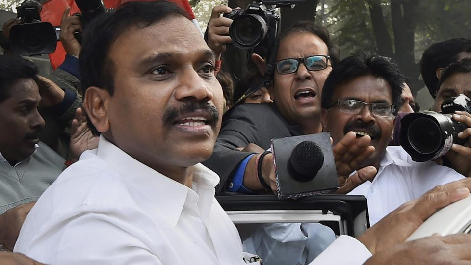 Former telecom minister A Raja reacts after he was acquitted by a special court in the 2G scam case.