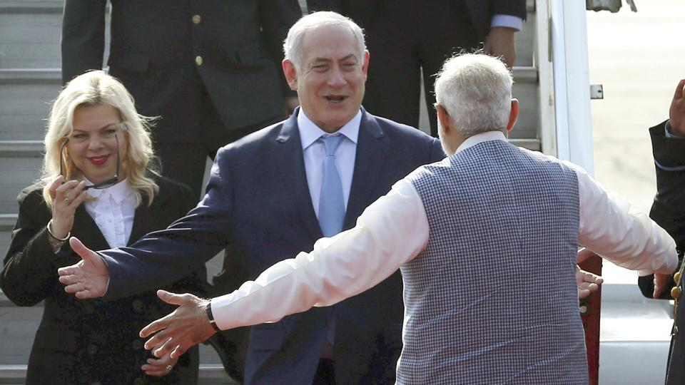 Israel's Prime Minister Benjamin Netanyahu and his wife Sarah are greeted by Indian Prime Minister Narendra Modi on their arrival at Palam airport in New Delhi on Sunday.