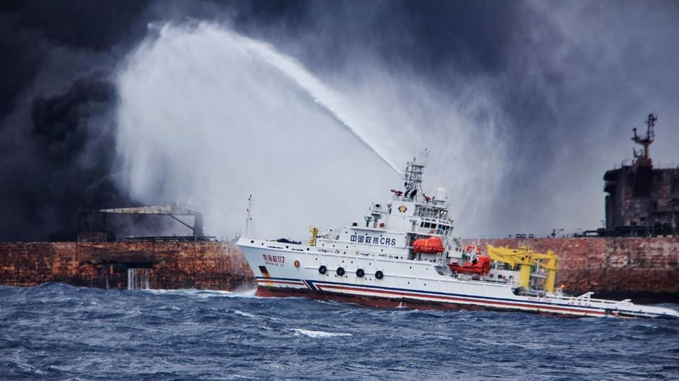 This handout picture shows the Chinese firefighting vessel spraying foam on the burning oil tanker at sea off the coast of eastern China.
