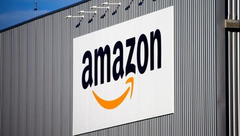 FILE - This Sept. 19 2013 file photo, the Amazon logo is seen on the new logistics center of online merchant Amazon in Lauwin-Planque, northern France
