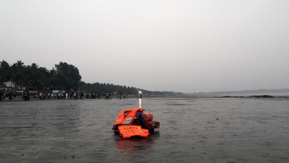 Flotation devices are seen lying at the site of a boat capsize in Dahanu.