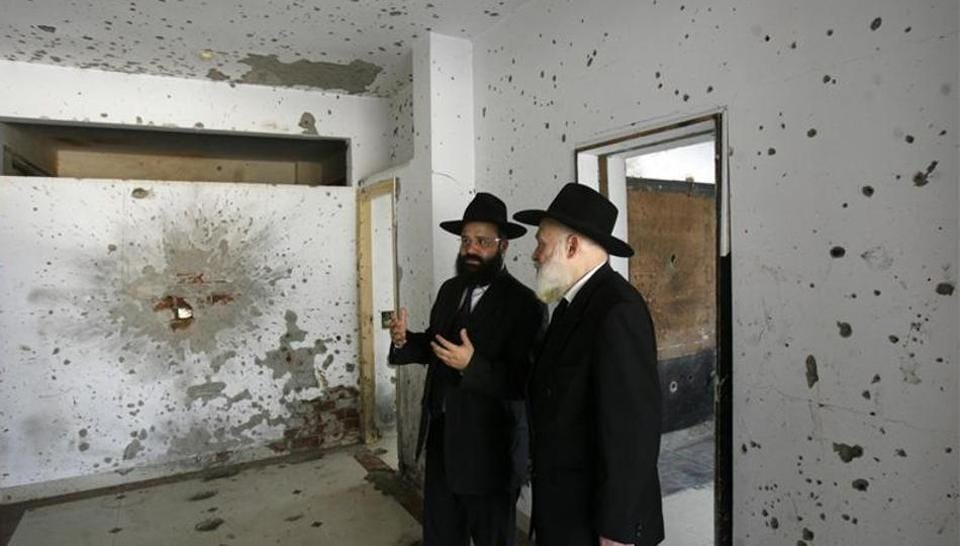 Rabbi Avraham Berkowitz (L) speaks with Chairman of Chabad network of international centres Rabbi Yehuda Krinsky as they visit the Nariman House in Mumbai November 25, 2009. Nariman House, home to the Mumbai chapter of the Chabad-Lubavitch Jewish movement, was one of 10 sites attacked by gunmen during a 60-hour siege in the city that began on November 26, 2008.