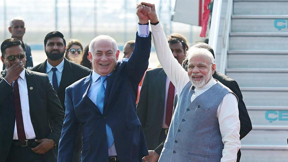 Prime Minister Narendra Modi with his Israeli counterpart Benjamin Netanyahu upon his arrival at Air Force station Palam in New Delhi on Sunday.