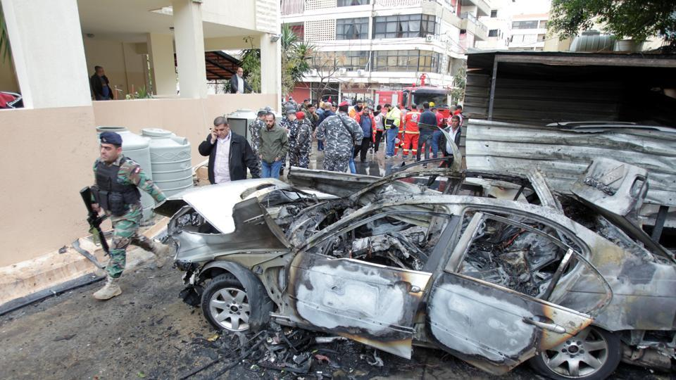 Lebanese soldiers are seen inspecting a damaged car in Sidon, Lebanon January 14, 2018.