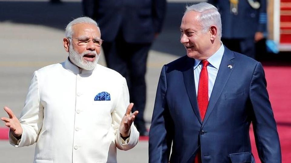 Israeli Prime Minister Benjamin Netanyahu welcomes Prime Minister Narendra Modi during an official welcoming ceremony upon his arrival in Israel at Ben Gurion Airport, near Tel Aviv, Israel July 4, 2017.