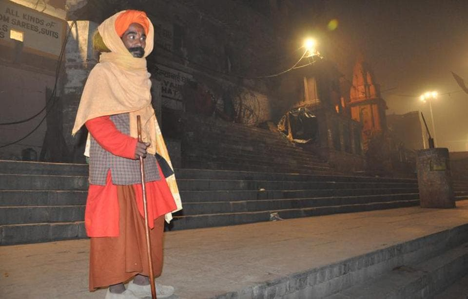 A sadhu stands firm in the cold.
