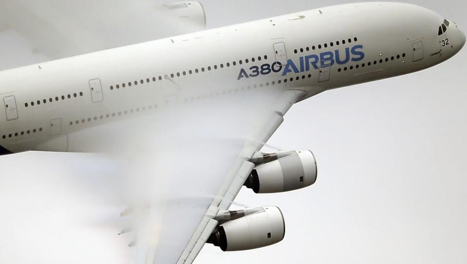 In this June 18 2015 file photo, vapor forms across the wings of an Airbus A380 as it performs a demonstration flight at the Paris Air Show, Le Bourget airport, north of Paris.