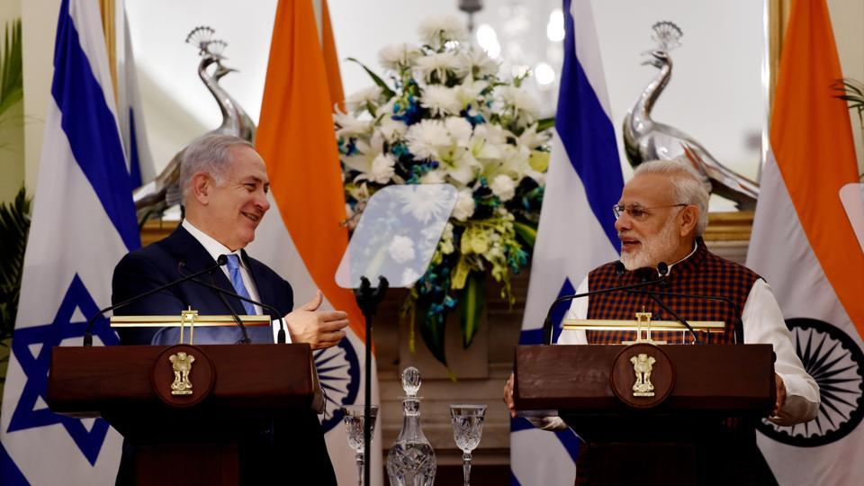 PM Narendra Modi speaks as Israeli Prime Minister Benjamin Netanyahu looks on during a press conference at Hyderabad House in New Delhi.
