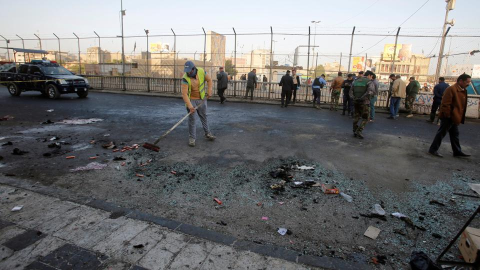 Iraqi security forces inspect the site of a bomb attack in Baghdad, Iraq.