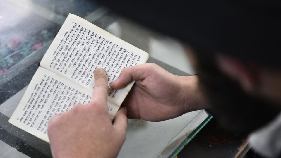 A Hasidic Jewish person reads from a Hebrew text. Chabad House is part of the Jewish community network headquartered in Brooklyn, New York. There are about 5,000 such centres, including 20 in India, advancing the orthodox Hasidic cause, a mystical Jewish movement founded in Poland in the 18th century in reaction to the rigid academicism of rabbinical Judaism. (Sanchit Khanna / HT Photo)