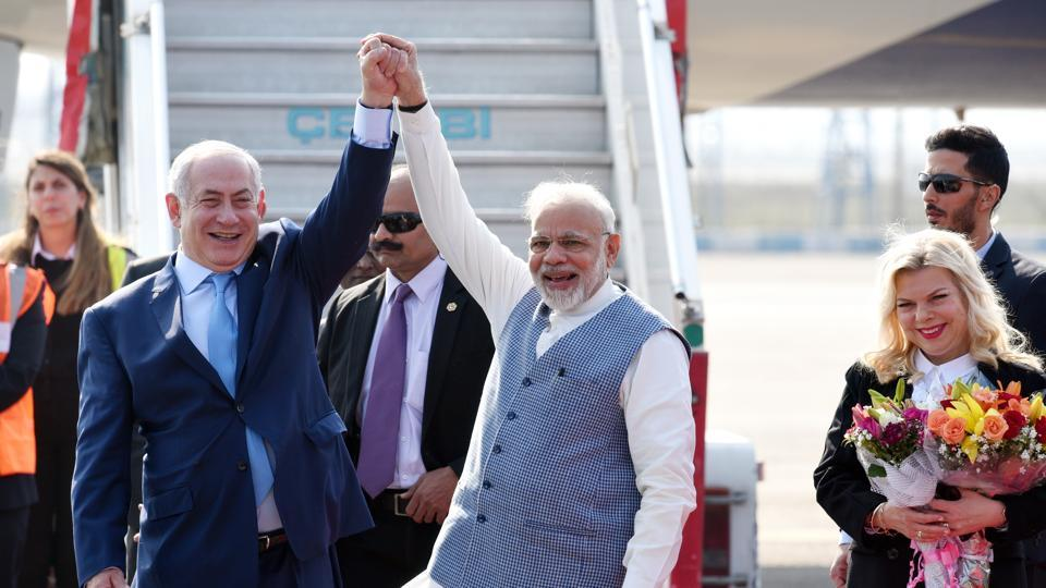 Prime Minister Narendra Modi welcomes Israeli Prime Minister Benjamin Netanyahu and his wife Sara Netanyahu on their arrival at the Air Force Palam airport Station in New Delhi India on Sunday