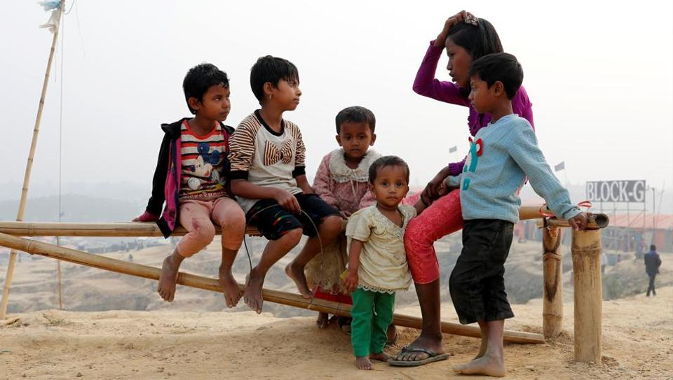 Rohingya refugee children talk to each other in Palong Khali camp, near Cox's Bazar, Bangladesh January 14, 2018.