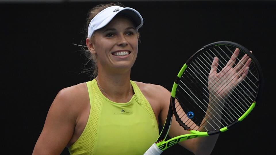 Wozniacki waltzes into Open second round
