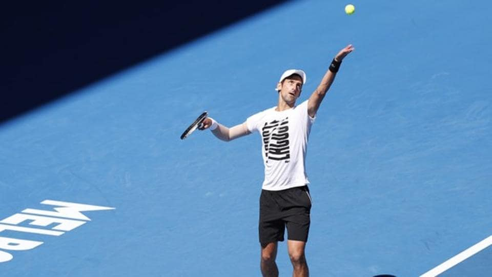 Novak Djokovic serves during a practice session before the Australian Open tennis tournament. Djokovic is set to return to action on Day 2 of the year's first Grand Slam.