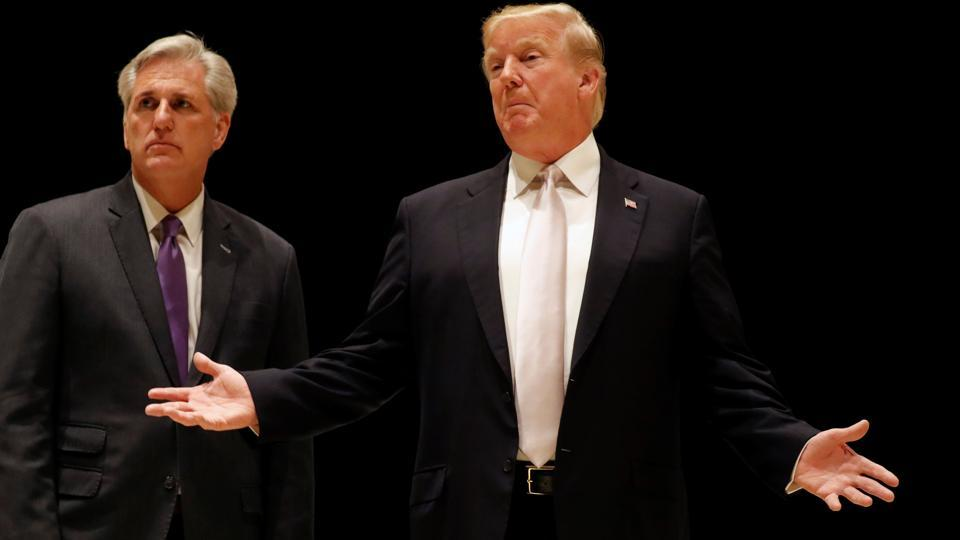 US President Donald Trump speaks as he and House Majority Leader Kevin McCarthy arrive for dinner at Trump's golf club in West Palm Beach, Florida.
