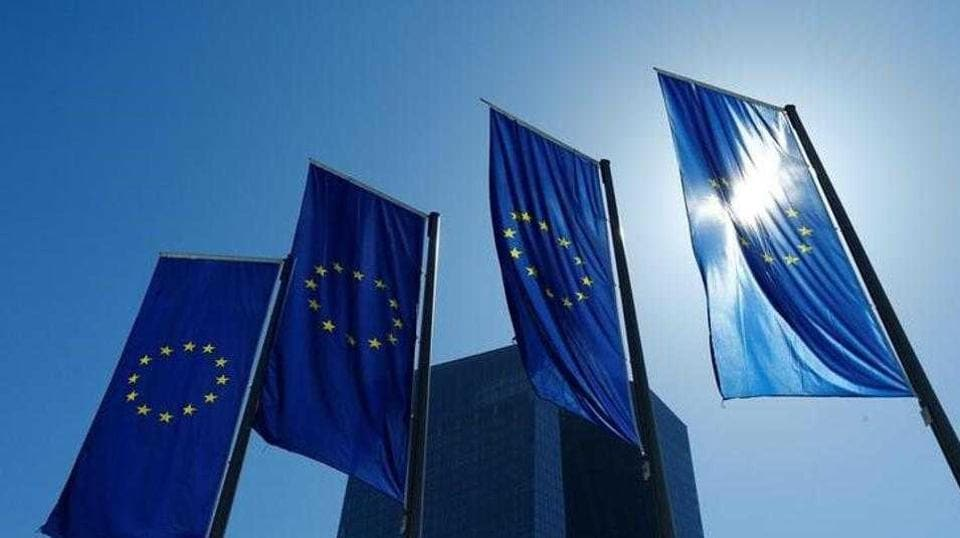 European Union flags flutter outside the headquarters of the European Central Bank in Frankfurt, Germany