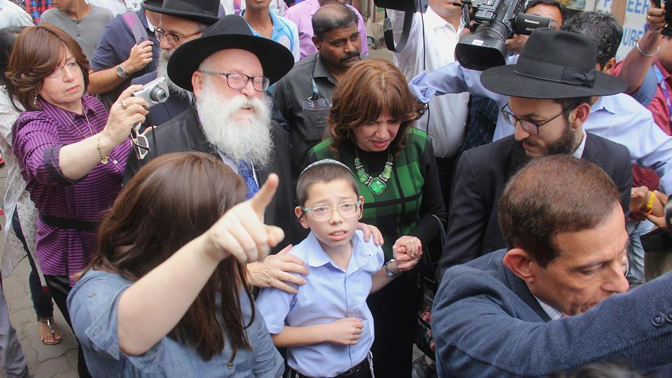 11-year-old Moshe Holtzberg , who lost his parents during the 2008 terror attacks, arrives with grandparents at Nariman House. (Bhushan Koyande/HT)