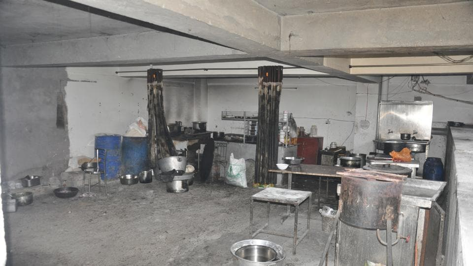A basement parking in a commercial complex on Chakrata Road in Dehradun being used as a kitchen.