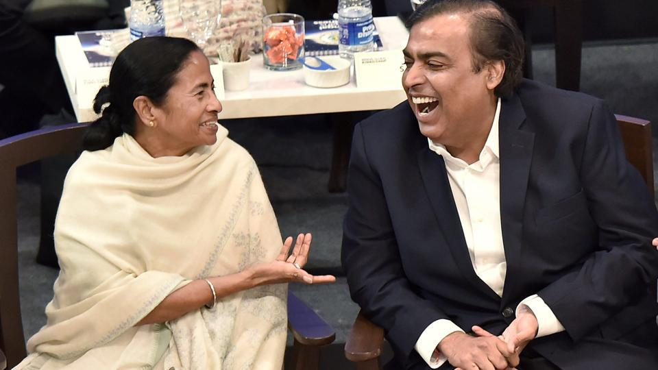 West Bengal chief minister Mamata Banerjee with RIL chairman Mukesh Ambani at the Bengal Global Business Summit, in Kolkata on Tuesday.