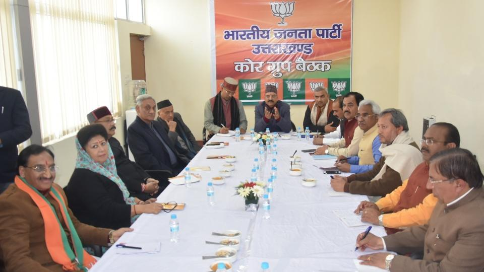 Chief minister TS Rawat, BJP state unit president Ajay Bhatt and others at the BJP meet on Tuesday.