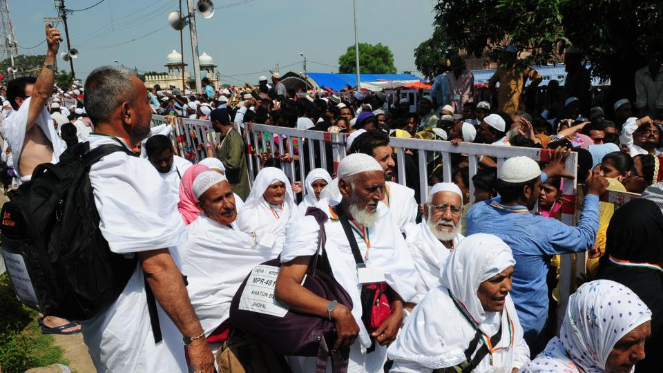 Haj pilgrims wave goodbyes to relatives and friends at Taj-ul-masajid transit point before leaving for Haj in Bhopal, in 2015.