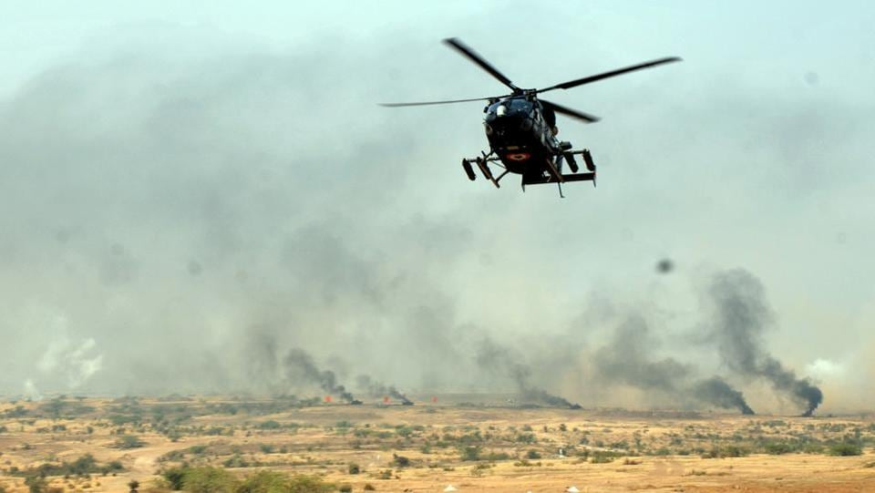 A Army helicopter takes part in a fire drill exercise at KK ranges, Ahmednagar  (HT PHOTO)