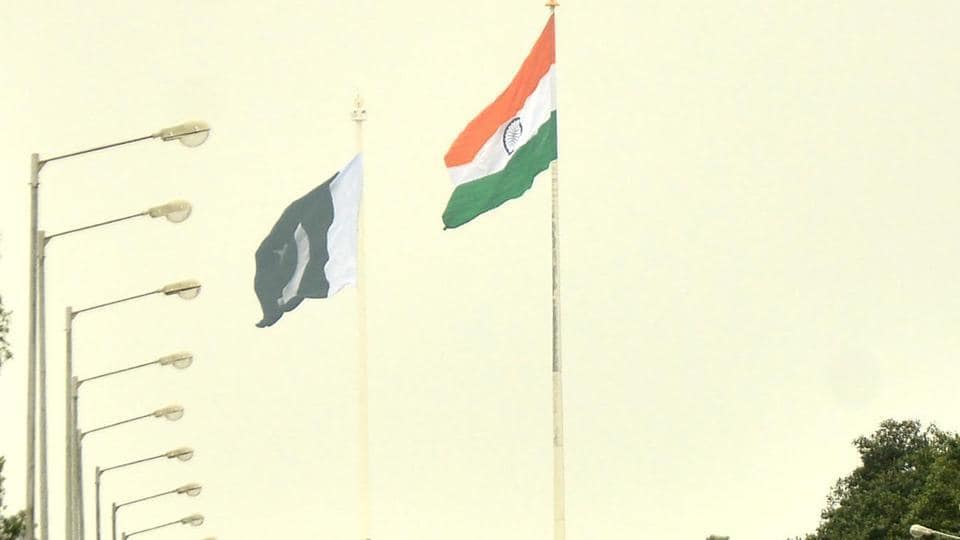 National flags of India and Pakistan on both sides of  the border at Wagha.