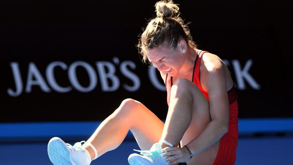 Romania's Simona Halep reacts after falling on the court during her match against Australia's Destanee Aiava. (REUTERS)