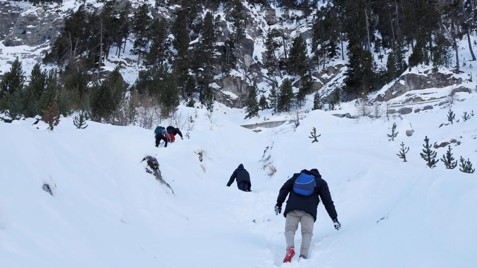 The terrain is steep and the group of five faced risks ranging from losing their footing on steep drops, being struck by falling rocks or succumbing to the -9C temperatures in ill-suited clothing. In a bid to evade increased border security at easier crossing points this group crossed into France in December. (Siegfried Modola / Reuters)