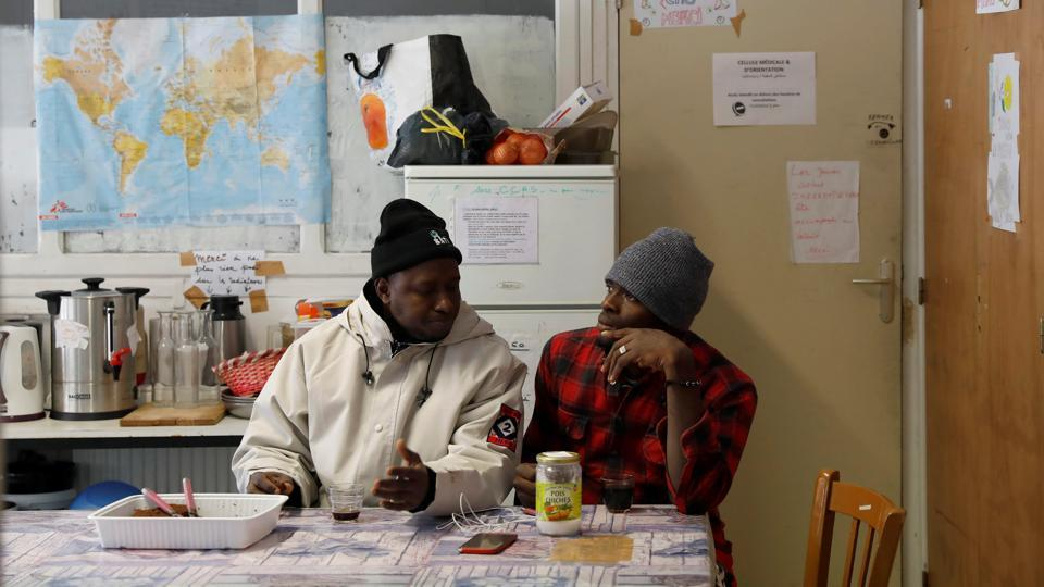 Abdullhai (L) and Abu (R) discuss their day having crossed part of the Alps mountain range from Italy into France, in the shelter centre of an organisation for migrants in the town of Briancon in southeastern France. (Siegfried Modola / Reuters)