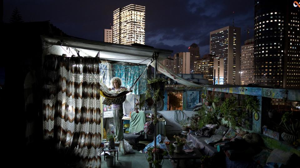 Ana Ashury, a mixed-media artist, stores away her artwork on her rooftop in Ramat Gan, a suburb of Tel Aviv. While she works as a video artist most of her time, Ana has recently started to use her rooftop work space as a workshop for collage creations. (Corinna Kern / REUTERS)