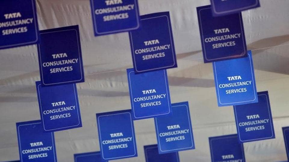 Logos of Tata Consultancy Services displayed at the venue of the annual general meeting of the software services provider in Mumbai.