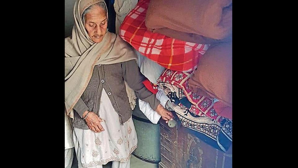 Gurdayal Kaur stands next to the wooden box in which she has kept the body of her grandson at Hathur village near Jagraon on Tuesday.