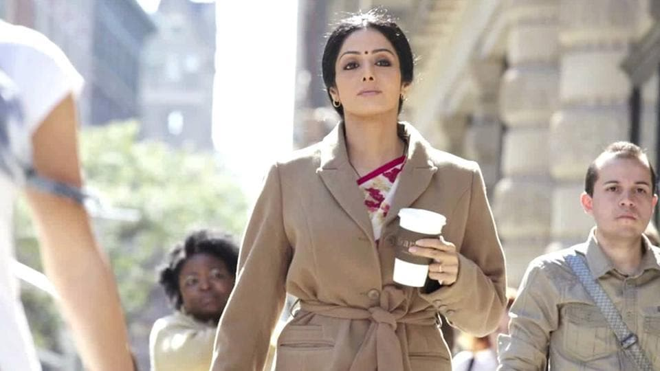 A still from the 2012 film English Vinglish. Sridevi look chic in a sari paired with a long coat.