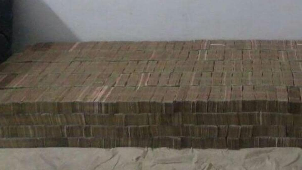 The currency notes were kept in bags stacked inside a bed from a builder's ancestral house in Kanpur.