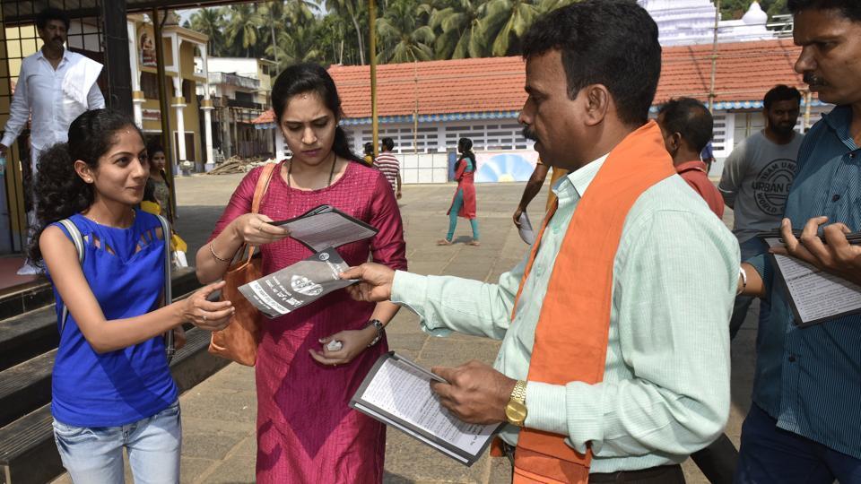 Bajrang Dal workers distributing leaflets for awareness against love jihad at Kadri Manjunatha Temple in Mangaluru on January 6.