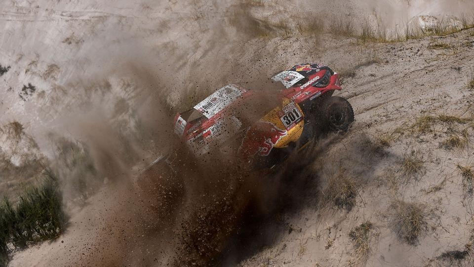 Toyota's Nasser Al-Attiyah of Qatar and his co-driver Matthieu Baumel of France negotiate a tricky climb during 10th stage of the Dakar Rally 2018 on Tuesday.