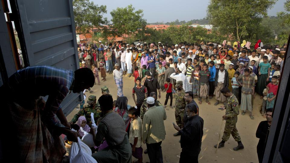Rohingya refugees receive relief material at Kutupalong refugee camp near Cox's bazar, Bangladesh, on January 16, 2018.