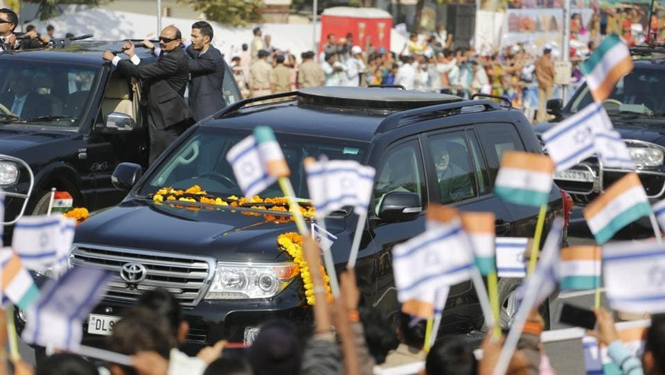Children wave to a vehicle carrying Israeli Prime Minister Benjamin Netanyahu and Indian Prime Minister Narendra Modi as they arrive at Gandhi Ashram in Ahmadabad. Unlike the roadshow in 2017 in an open vehicle by PM Narendra Modi and Japan's Shinzo Abe, the prime ministers this time opted for bullet-proof cars. (Ajit Solanki / AP)