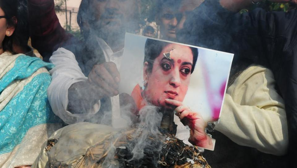 "Congress workers and supporters burn an effigy of then union HRD minister Smriti Irani in Bhopal. Irani's statement that Vemula's death was not a ""Dalit versus non-Dalit issue"" and that there was a ""malicious attempt to project it as a caste battle"" sparked further outrage. (Mujeeb Faruqui / HT Photo)"