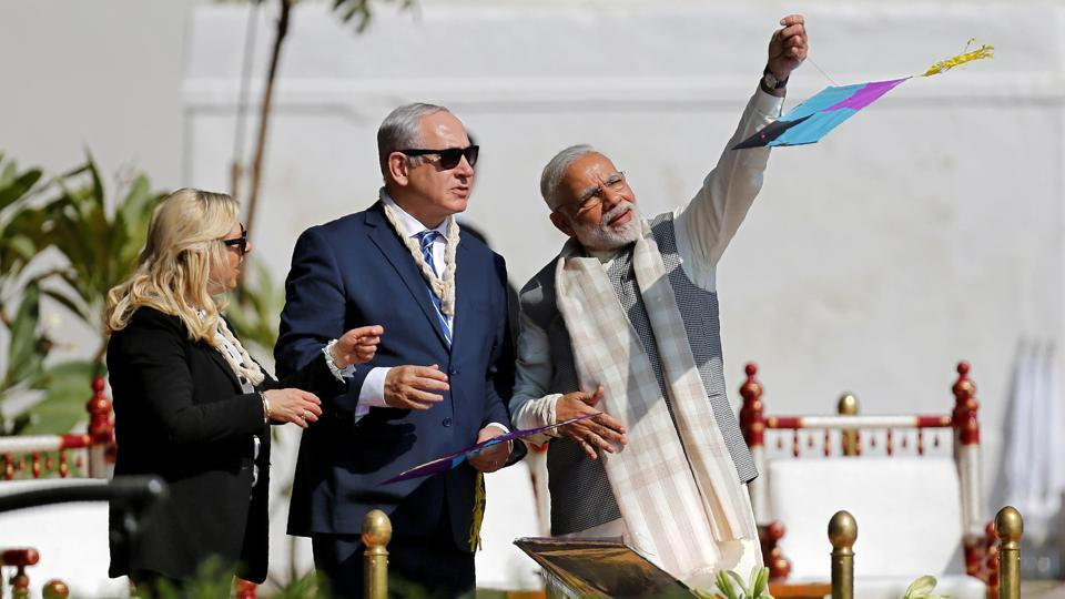 Prime Minister Narendra Modi flies a kite watched by Benjamin and Sara Netanyahu. (Amit Dave / REUTERS)