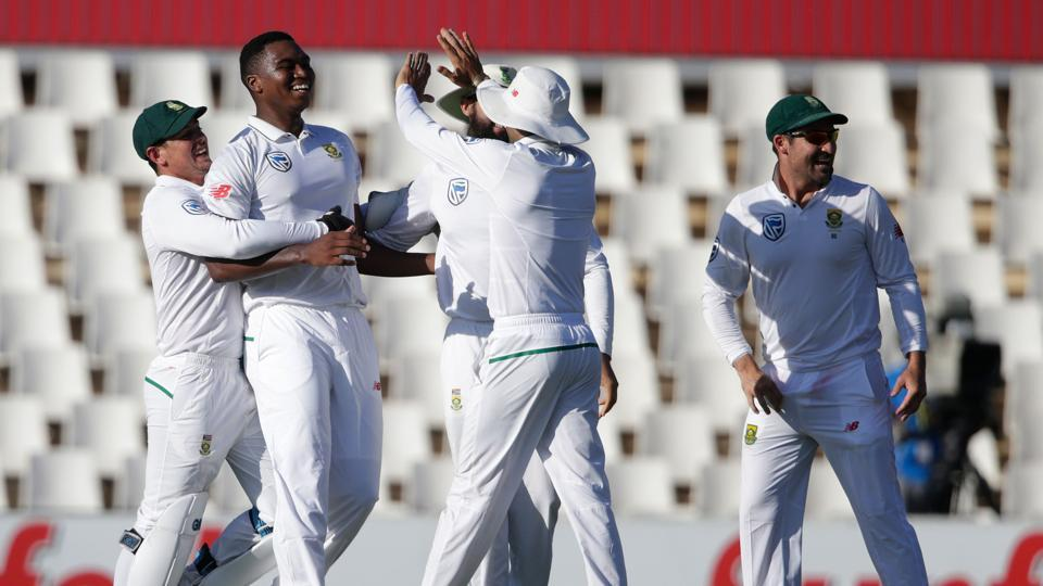 South African bowler Lungi Ngidi (2nd from L) celebrates the dismissal of Indian captain Virat Kohli (not in picture) during the fourth day of the second Test cricket match between South Africa and India at Supersport cricket in Centurion.